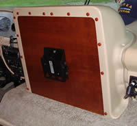 Replacing the doghouse TV shroud into the RV
